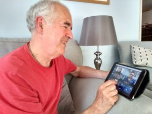 Carer using video conference technology